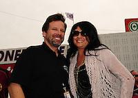 Nov. 10, 2011; Pomona, CA, USA; NHRA top fuel dragster driver Del Worsham with wife Connie Worsham during qualifying at the Auto Club Finals at Auto Club Raceway at Pomona. Mandatory Credit: Mark J. Rebilas-.
