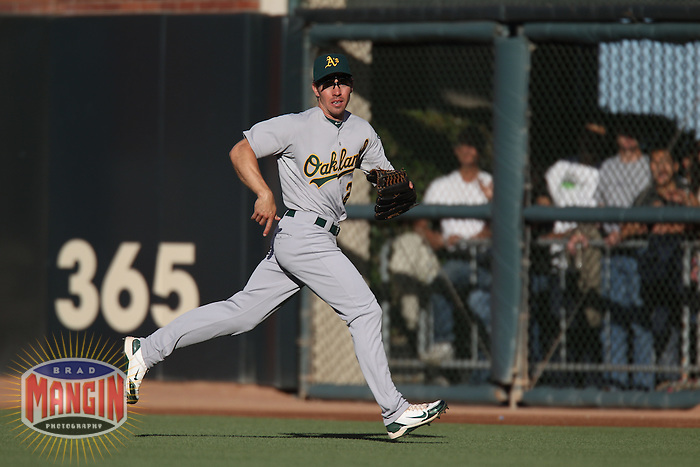 SAN FRANCISCO - JUNE 12:  Matt Carson #25 of the Oakland Athletics chases a ball in right field against the San Francisco Giants during the game at AT&T Park on June 12, 2010 in San Francisco, California. Photo by Brad Mangin