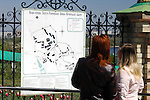 Travel stock photo of Two women tourists looking at Ukrainian Map of Kievo-pecherskaya lavra - Kiev pechersk lavra - Cave monastery in Kiev Ukraine Eastern Europe Red arrows show the way to caves May 2007