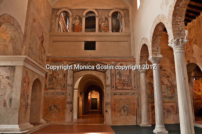 Church of San Salvatore which is a culimination of different centuries from the Roman ruins to 6th century columns to 15th and 16th century frescos; The Church of San Salvatore in the Santa Giulia Museum Complex in Brescia, Italy