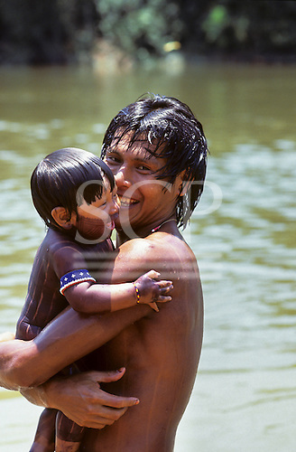 A-ukre village, Brazil. Bengoti Kayapo with his child Gordon Kayapo; Xingu Indigenous Area, Para State.