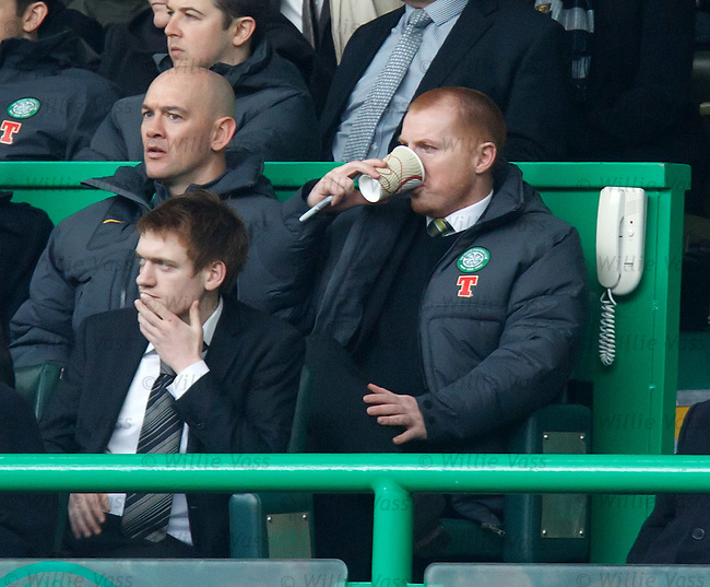 Neil Lennon in the stand with his half-time drink