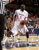 CHARLOTTESVILLE, VA- DECEMBER 6: Assane Sene #5 of the Virginia Cavaliers handles the ball during the game on December 6, 2011 against the George Mason Patriots at the John Paul Jones Arena in Charlottesville, Virginia. Virginia defeated George Mason 68-48. (Photo by Andrew Shurtleff/Getty Images) *** Local Caption *** Assane Sene