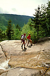 New Hampshire: Hikers on Appalachian Trail to Zealand Hut,  Model Released.  Photo #: nhappa101..Photo copyright Lee Foster, www.fostertravel.com, 510/549-2202, lee@fostertravel.com