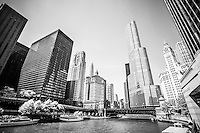 Black and white picture of downtown Chicago at Michigan Avenue Bridge (DuSable Bridge) with the Chicago River, One Illinois Center, 333 North Michigan Avenue, London Guarantee Building, Leo Burnett Building, United Airlines Building, Trump Tower, and Wrigley Building.