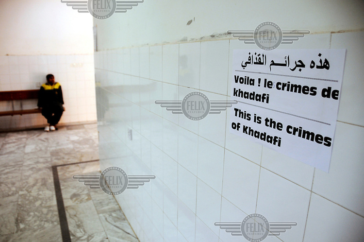 A propaganda slogan reading 'This is the crimes of Khadafi' on a wall at the entrance to the hospital in Ajdabiya, where wounded rebel soldiers are brought. On 17 February 2011 Libya saw the beginnings of a revolution against the 41 year regime of Col Muammar Gaddafi.