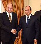 Egyptian President Abdel Fattah al-Sisi shakes hands with German Minister for Agriculture and Food Christian Schmidt, during a meeting in Cairo, Egypt, on April 11, 2017. Photo by Egyptian President Office