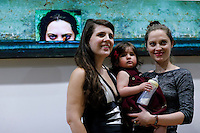 """Stamford, CT. 11 October 2014. Colombian Artist Evelin Velasquez (1L) attends the Opening of her solo Exhibit """"Transfigurations"""" at the Fernando Luis Alvarez Gallery in Stamford . Photo by Eduardo Munoz/VIEWpress"""
