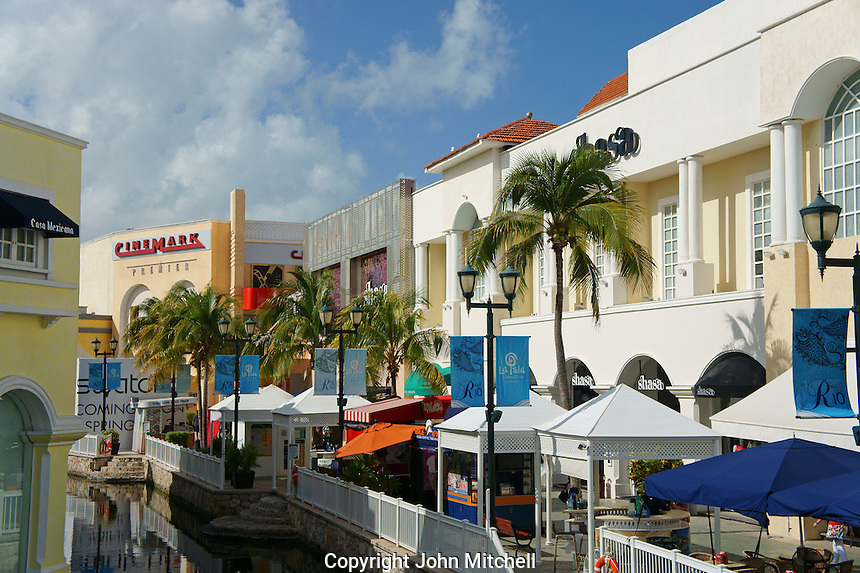 Waterway, outdoor restaurants, and shops in La Isla Shopping Village mall in the Zona Hotelera, Cancun, Quintana Roo, Mexico..