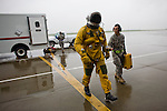 "U2 pilot Major Eric Shontz walks to his U2 before a ""high-flight"" at Beale Air Force Base February 24, 2010 in Linda, Calif."