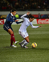 Lorient, France. - Sunday, February 8, 2015:  Kenza Dali (7) of France and Christen Press (23) of the USWNT. France defeated the USWNT 2-0 during an international friendly at the Stade du Moustoir.