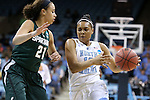 25 March 2014: North Carolina's Allisha Gray (15) and Michigan State's Klarissa Bell (21). The University of North Carolina Tar Heels played the Michigan State University Spartans in an NCAA Division I Women's Basketball Tournament First Round game at Cameron Indoor Stadium in Durham, North Carolina. UNC won the game 62-53.