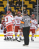 Conor Morrison (Harvard - 38), Charlie Coyle (BU - 3), Garrett Noonan (BU - 13), Chris Connolly (BU - 12) - The Harvard University Crimson defeated the Boston University Terriers 5-4 in the 2011 Beanpot consolation game on Monday, February 14, 2011, at TD Garden in Boston, Massachusetts.