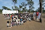 Children recite basic vocabulary in English in an open air classroom under a tree in the Yusuf Batil refugee camp in South Sudan's Upper Nile State. More than 110,000 refugees were living in four camps in Maban County in October 2012, but officials expected more would arrive once the rainy season ended and people could cross rivers that block the routes from Sudan's Blue Nile area, where Sudanese military has been bombing civilian populations as part of its response to a local insurgency. Conditions in the camps are often grim, with outbreaks of diseases such as Hepatitis E.