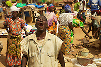 guy in a public market, Benin, West Africa