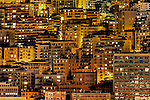 Dense cluster of city buildings at night.
