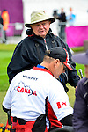 LONDON, ENGLAND /08/2012 - Norbert Murphy chats with Vladimir Kopecky while competing in the Men's Individual Compound W-1 Ranking Round at the London 2012 Paralympic Games at the Royal Artillery Barracks. (Photo: Phillip MacCallum/Canadian Paralympic Committee)