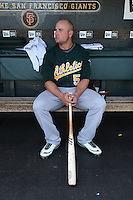 SAN FRANCISCO - JUNE 14:  Matt Holliday #5 of the Oakland Athletics gets ready in the dugout before the game against the San Francisco Giants at AT&T Park on June 14, 2009 in San Francisco, California. Photo by Brad Mangin