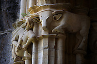 Detail of a sculpted capital in the cloister of Monestir de Santa Creus, Aiguamurcia, Catalonia, Spain, pictured in May 21, 2006, in the morning. This  capital depicts a craftsman holding a tool and a beautifully carved cow crouching on the capital. The Cistercian Reial Monestir Santa Maria de Santes Creus and its church were built between 1174 and 1225. Following strict Cistercian rule, the Romanesque complex originally featured no architectural embellishments with the exception of ornamented capitals and crenellations on the rooflines. In the 13th century the cloister was converted in Gothic style by James II of Aragon. Picture by Manuel Cohen.