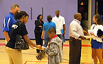 UK staff and students talk with Wells Brown elementary students after an academic pep rally, hosted by UK's two time basketball national champion Wayne Turner, Friday, September 24, 2010.Turner has returned to UK to complete his degree and will graduate in May.  Photo by Theresa | Staff