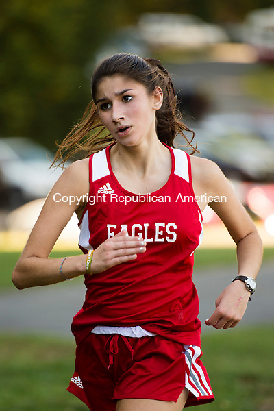 WATERTOWN, CT- 15 September 2015-091515EC07-  Wolcott's Alize Rodriguez finishes fourth in the cross country 5k at Veteran's Memorial Park in Watertown. The Watertown team swept the girls' race with first, second and third places. Erin Covey Republican-American