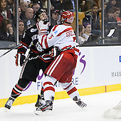 Braden Pimm (NU - 14), Matt Grzelcyk (BU - 5) - The Northeastern University Huskies defeated the Boston University Terriers 3-2 in the opening round of the 2013 Beanpot tournament on Monday, February 4, 2013, at TD Garden in Boston, Massachusetts.