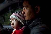 Pornlert Prompanya, 32, drives to get breakfast with his son Asia, 2, before the tourist rush hits his boat touring business on the Mekong River in Sop Ruak, Thailand. Photo taken on Thursday, December 10, 2009. Kevin German / Luceo Images