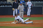 Ole Miss' Tanner Mathis (12) is safe at third vs. Memphis' Drew Griffin (7) at Oxford-University Stadium in Oxford, Miss. on Tuesday, February 26, 2013. Memphis won 4-3. Ole Miss falls to 7-1.