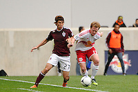 Kosuke Kimura (27) of the Colorado Rapids and Dax McCarty (11) of the New York Red Bulls battle for the ball. The New York Red Bulls defeated the Colorado Rapids 4-1 during a Major League Soccer (MLS) match at Red Bull Arena in Harrison, NJ, on March 25, 2012.