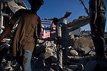 Men break up and sort through a collapsed building in the Bas Fort National neighborhood of Port-au-Prince. The 7.0 earthquake that devastated parts of Haiti on January 12 killed hundreds of thousands of people. January's earthquake killed hundreds of thousands of people and caused significant and lasting structural and economic damage in the Caribbean nation.