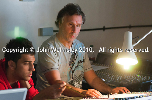 """Working the lighting and sound desk, dress rehearsal for school production of """"Bugsy Malone"""", state secondary school."""