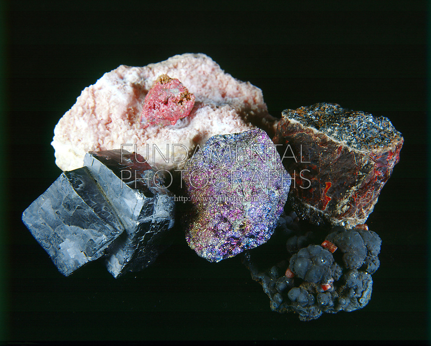 METAL ORES<br /> Clockwise From Top Left: Mn w/Hg, Zn, MG, Fe, Cu, Pb<br /> Cinnabar- Mercury (Hg); Rhodochrosite- Manganese (Mn); Zincite- Zinc (Zn); Goethite- Iron (Fe); Bornite- Copper (Cu) &amp; Galena- Lead (Pb)