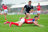 Pat Jenkinson of Great Britain scores his team's second try of the match. FISU World University Championship Rugby Sevens Men's Semi Final between Great Britain and France on July 9, 2016 at the Swansea University International Sports Village in Swansea, Wales. Photo by: Patrick Khachfe / Onside Images