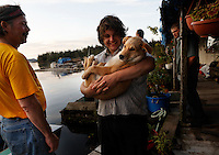Marcus Lee lives on Piggy Cove--named for a pot belly pig they had for 12 years and holds the dog they have named Meatball. He lives with Swede and Shirley Ecklund on a  float house where transportation is only by boat or float plane.