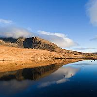 Reflection in lochan, Black Cuillin hills, Glenbrittle, Isle of Skye, Scotland