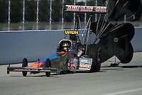 Feb. 10, 2012; Pomona, CA, USA; NHRA top fuel dragster driver Terry McMillen during qualifying at the Winternationals at Auto Club Raceway at Pomona. Mandatory Credit: Mark J. Rebilas-