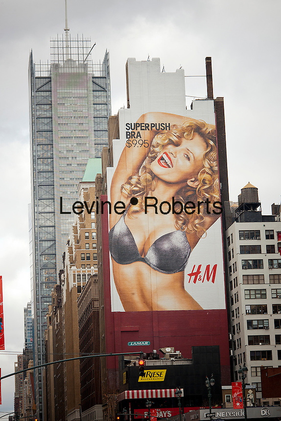 """A billboard for H&M's """"super push bra"""" in the Herald Square shopping district in New York is seen on Friday, December 23, 2011.  (© Richard B. Levine)"""