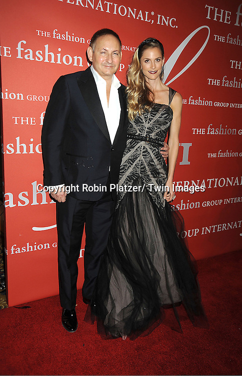 John Demsey and Annalise Peterson attends the Fashion Group International's 29th Annual  Night of Stars Gala on October 25, 2012 at Cipriani Wall Street in New York City.