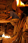 A craftsman makes tables in the busy marketplace in Marrakesh, Morocco..