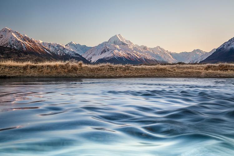 Winter sunrise looking across the Tasman River towards Aoraki / Mt Cook covered in snow, Mackenzie Country, Canterbury, New Zealand - stock photo, canvas, fine art print