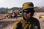 Operation 'retour' set up  by UNHCR  to repatriate 1,000,000  Hutu's who have fled to camps in Goma, Zaire, back to Rwanda fearing reprisals for the genocide of Tutsi's..The Zairean military (president Mobutus'presidential guard) was used to monitor the operation..Kahunda camp, Goma, Zaire.