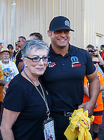 Jul 24, 2016; Morrison, CO, USA; NHRA funny car driver Matt Hagan (right) with former driver Shirley Muldowney during the Mile High Nationals at Bandimere Speedway. Mandatory Credit: Mark J. Rebilas-USA TODAY Sports