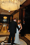 Bride and Groom celebrate under the crystal chandelier in the elegant lobby of the Essex House, NYC...