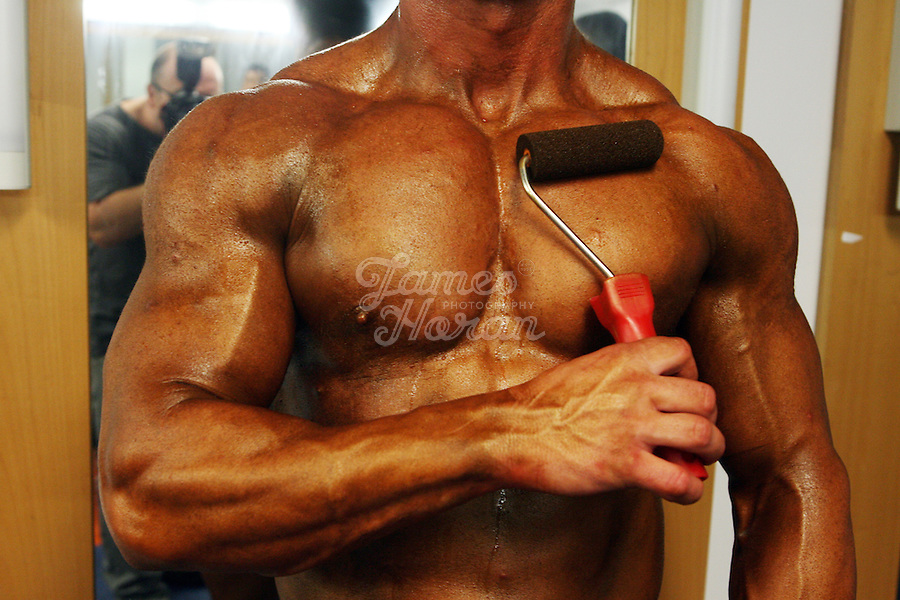 A competitor is pictured applying his fake tan with a roller backstage at the RIBBF (Republic of Ireland Body Building Federation) National Championships held in Limerick at the Millennium Theatre, LIT, Ireland.Picture James Horan/Photocall Ireland