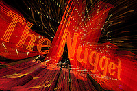 """The Nugget""  This Nugget sign was photographed in Downtown Reno, Nevada. The effect was obtained in camera by long exposure mixed with intentional camera movement."