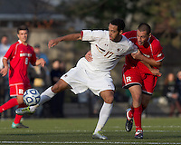 Boston College forward Charlie Rugg (17) controls the ball as Rutgers University defender Andrew Cuevas (5) pressures. Rutgers University defeated Boston College in penalty kicks after two overtime periods in NCAA Division I tournament action, at Newton Campus Field, November 20, 2011.