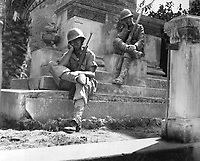 Sgt. Norwood Dorman, Benson, N.C., stops to rest at the memorial to the Italian soldier of World War I, Brolo, Sicily.  August 14, 1943.  Lt. Robert J. Longini. (Army)<br /> NARA FILE #:  111-SC-179879<br /> WAR &amp; CONFLICT BOOK #:  1026