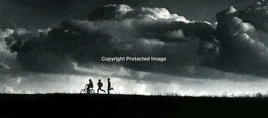 Kids race home to beat the coming storm. Photo in Lafayette, California. (photo by Ron Riesterer)
