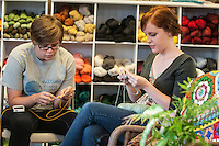 STAFF PHOTO ANTHONY REYES &bull; @NWATONYR<br /> Katharine Arthurs, left, of Springdale, and Geneva Stewart, of Fayetteville, crochet and knit Thursday, Sept. 18, 2014 during a class at Mockingbird Moon in Rogers. Arthurs is crocheting a dishcloth while Stewart is knitting one.