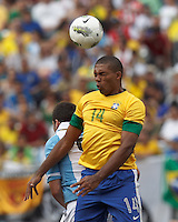 Brazil defender Juan (14) heads the ball. In an international friendly (Clash of Titans), Argentina defeated Brazil, 4-3, at MetLife Stadium on June 9, 2012.